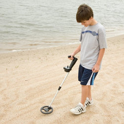 Bounty Hunter - Bounty Hunter Junior Metal Detector Multicolor - BHJS - Shop for Metal Detectors from Hayneedle.com! Can't find it? Send the kids out with this Bounty Hunter Junior Metal Detector. Designed especially for junior detectorists this product is the perfect gift for a young enthusiast. Featuring a special discrimination control it will leave iron and other unwanted items undetected unless you decide otherwise.The Bounty Hunter Junior Metal Detector provides professional-level features in junior size at an affordable price. Your junior detectorist will be entertained for hours hunting for buried treasure. This detector is lightweight ergonomic and has an adjustable shaft to grow with your child and their sense of adventure. The Bounty Hunter Junior's metal-detecting coil is weather-resistant and the control panel includes an easy-to-use intensity meter sensitivity control discrimination control and low-battery indicator.The Bounty Hunter Junior Metal Detector Features:Target Indicator: Provides visual cue of nearing targetPower Control: Reduces electromagnetic interferenceEliminator Control: Eliminates unwanted metals from detectionOne-Tone Audio Feedback: Increases as target nearsLow-Battery Indicator6.5-inch Weather-Resistant Closed CoilAdjustable Shaft: Extends up to 2.25 inchesThe Bounty Hunter Junior Metal Detector Specifications:Depth Detection: 5 inches for coin-size objects; 2 feet for large objectsOperates on Two 9-Volt Alkaline BatteriesVisual Target System: Intensity MeterPreset Ground Balance: Neutralizes the response to ground mineral contentModes of Operation: Motion all-metal mode and progressive discriminationAudio Feedback: Internal speakerLightweight Ergonomic DesignApplicationsKeeping kids busy for hours! Coin ShootingRelicJewelryCache HuntingLocating Property Markers or Household items About Bounty Hunter/First Texas ProductsBounty Hunter metal detectors are made by First Texas Products a company with over 30 years of experience and a l