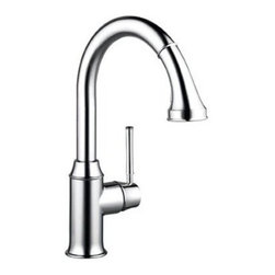 Hansgrohe Talis C 04215 Single Handle Pull Down Kitchen Faucet - Classic and modern are brought together in the Hansgrohe Talis C 04215 Single Handle Pull Down Kitchen Faucet to give your kitchen a unique styling you'll adore. Made from solid brass, you know that this faucet is ready take on bacteria and corrosion without batting an eye. The spout arcs high and even swivels so those large pots and pans can easily get into the basin. For a quick and convenient wash, just pull down the head of the spout to double as a strong sprayer. The single handle makes for simple operation while leaving a hand free for multitasking.Product Specifications:Mount Type: Deck MountHandle Style: LeverValve Type: Ceramic DiscFlow Rate (GPM): 2.2Swivel: 360 degreesSpout Height: 9.38-inchSpout Reach: 8.75-inchAbout the Hansgrohe GroupIn 1901, the Hansgrohe Group was founded in Schiltach in the Black Forest in Germany by Hans Grohe. Headquarters for Hansgrohe are still located there today. With a firm establishment in the sanitation industry, Hansgrohe offers progressive, design-oriented bathroom solutions and cutting-edge bathroom products. Successful world-wide, Hansgrohe has 10 production facilities on three continents, and sales companies and consulting support locations in 36 countries. Hansgrohe's five-star recipe for success includes, innovative products, a sustainable business concept, and the passion for the element of water..