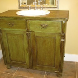 Antique sideboard used as bathroom vanity - One of our antique sideboards used as a bathroom vanity in Parade of Homes house.  Custom finish.