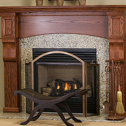 Huntington Wood Fireplace Mantel - Shown in red oak with a rich mahogany stain, the Huntington fireplace is available in four wood finishes sure to beautify your room.