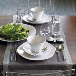 duo grey placemat for two - party of two. Two-tone grey linen crosses the table to mat/mate two diners on opposite sides of the table. Get three for six guests, four for eight, you get the idea. Runner frames dark grey linen with light border.- 100% linen- Drape placemat across two placesettings- Machine wash- Made in India- See dimensions below