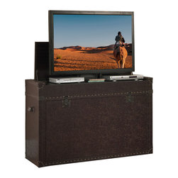 "Touchstone Home Products - Ellis Aged Cigar Leather Truck TV Lift Cabinet for Flat Screen up to 46"" - The Ellis Trunk is one of our most popular TV lift cabinets that really shows it's versatility in just about any room in the house. Old World style meets modern technology in this steamer trunk styled show piece. The rich leather exterior in an aged cigar hue, artfully weathered and worn makes this TV lift cabinet a timeless piece for the home. The trunk features leather strap details and rugged hand-hammered grommets to lend an old world appeal to the modern technology housed inside. A treasure piece that is ideally suited for an end of bed location, bringing a unique and evocative styling to your bedroom decor. The Ellis Trunk is finished on both sides allowing you the freedom to use it as an end of bed cabinet or the focal point of your entertainment center in a living room, man cave, den, family room, or study. The cabinet comes equipped with a built-in shelf for components that rises with the TV and delivers the ultimate bedroom theater experience."