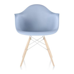 """Herman Miller - Herman Miller Eames Molded Plastic Armchair Dowel Base - This enduring chair, originally designed in 1948 by Charles and Ray Eames, epitomises the designers' mantra of """"the best for the most for the least."""" Updated with modern materials, the moulded shell in recyclable polypropylene provides an interesting visual contrast to the solid wood dowel base."""