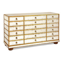 Aged Eglomise Chest - Like the appurtenances that grace the boudoirs of manses in Chantilly, the Aged Eglomise Chest blends beauty with practicality. Covered with glimmering aged mirror, the chest presents antique gold leaf accents and exquisite brass loop hardware. Twelve generously sized drawers allow for containment of personal treasures or delicate belongings.