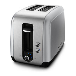 KitchenAid - KitchenAid  RKMT211CU Contour Silver 2-slice Toaster (Refurbished) - Extra wide slots and a manual high lift lever ensure that your snack will never get stuck in this high-powered KitchenAid toaster. A removable crumb tray keeps clean up easy and the adjustable shading control eliminate the burning.