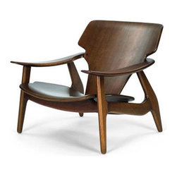 Diz Armchair by Sergio Rodrigues - Such a beauty. I'd tuck this dream chair away in a little reading nook.