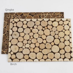 VivaTerra - Tree Ring Placemats - These placemats look printed from a distance, but don't be fooled! They are made from lumbered birch and qingke trees in northwest China and will add a bit of  rustic chic to your dinner party.