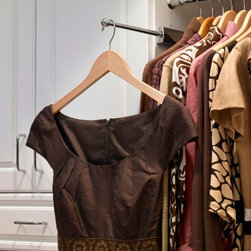 Closet Accessories - Set your clothes out for the next day with extendable valet rods. These rods can be customized to fit into any space and tailored to your height and specifications.
