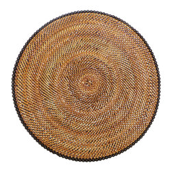 Calaisio - Round, Rattan Placemat with Black Beads - These hand woven placemats are created from a water vine that only grows in the mountainous areas of the South Pacific. Once reaped it grows back quickly, leaving no damage in these ecologically sensitive forests. They can be easily rinsed off because of the durability of the material. Each piece has a card attached, signed by the artisan that created it. It also lists the time it took for he or she to weave. More are available with a longer lead time.