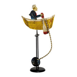 """Inviting Home - Salty Dog Balance Toy - salty dog balance toy; 9-1/2""""x 4""""x 17-3/4""""H; Salty Dog balance toy. Functioning skyhook replica of 19th C. classic seasonal accessories. One of the least liked and heaviest jobs o f the Sailing Age was for the sailor to row out the ship's anchor and place it in position. Sometimes several anchors were needed to make for a safe and secure berth. - hand made from recycled metal sheet; - cut by hand using original templates; - hand painted in great details; - finished in aged patina waxed; - counterweight calibrated to create swing; - come with matching metal stand; Gadgets inspired by science were popular in Victorian times. People loved demonstrations of the seemingly impossible. Optical illusions magnetic forces the laws of gravity all seemed magical in an era when society was changing fast and industrial revolution was unstoppable. Skyhooks could be set on a shelf or the rim of the table and set in motion to everybody's delight and amazement."""