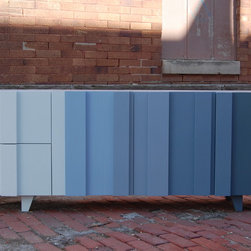 Ombre Console - This console is built with maple and finished with a tinted lacquer. It has doors and drawers fronts that differ in thickness, solid maple drawer boxes, adjustable shelves and soft close doors. There are six colors with the feet matching the front color above it.