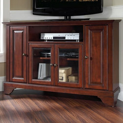 Crosley - Crosley LaFayette 48 in. Corner TV Stand - Vintage Mahogany Brown - KF10006BMA - Shop for Visual Centers and Stands from Hayneedle.com! Upgrade your home decor with the Crosley LaFayette 48 in. Corner TV Stand - Vintage Mahogany. This entertainment console fits into any corner to maximize space and holds up to a 52-inch wide flat panel TV. It features solid hardwood and veneer construction finished in a multi-step hand rubbed vintage mahogany accented by antique brass hardware. Two side cupboards with raised panel doors and an adjustable shelf provide ample space for your DVD and game library. Two tempered glass doors house your media player on an adjustable shelf. An open shelf and cord management feature hold electronic components and keep wires under control. Classic design packed with modern features!Additional Features:Accommodates up to a 52-inch flat panel TVLower cabinet with adjustable shelving1 open adjustable center shelf2 side piers with 1 adjustable shelf eachCord management featureAbout Crosley FurnitureIn 1920 Powel Crosley founded the company that pioneered radio broadcasting and mass market manufacturing around the world starting with a simple radio meticulously crafted with obsessive detail and accuracy and a measure of consideration for the wallet. These high ideals have served the company well for over 90 years and they live on in the newest addition to the family. Crosley Furniture sets a new standard for innovation function and meticulous craftsmanship in the manufacture of value-priced furniture. They proudly offer durable furniture products featuring hardwood and veneer construction with rich multi-step finishes in a multitude of styles.