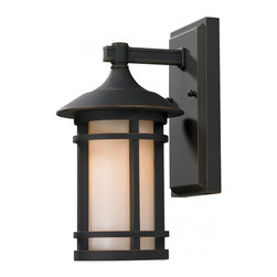 One Light Oil Rubbed Bronze Matte Opal Glass Wall Lantern - Clean contemporary styling on a traditional look make this small wall mount fixture well suited for any home. The light has oil rubbed bronze finish with matte opal glass.