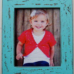 MyBarnwoodFrames - Rustic Malibu Blue Distressed Wood Frame, 8x10 - An  attractive  rustic  blue  picture  frame  to  give  new  life  to  your  beach-themed  or  nautical  decor.  This  pretty  robin's  egg  blue  frame  (aqua)  is  Hand  distressed  for  a  shabby  chic  look  that  you  will  love.  Beautiful  two-inch-wide  frame  face  is  thick  enough  to  give  your  photos  substance.                  8x10  opening              Exterior  dimensions:  11.5  x  13.5              Includes  glass,  backing  and  hanging  hardware              Add  an  easelback  if  shelf  display  is  desired              Hand-distressed;  Made  in  USA