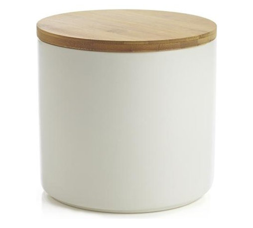 Silo 64 oz. Canister - Clean, contemporary styling in durable stoneware, warmed by a winter-white glaze and natural bamboo lid. Silicone lid gasket forms a tight seal, locking in freshness and locking out moisture. Stackable canisters store staples in style on the countertop or pantry.