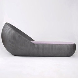 Lebello - Lebello | Circle Chaise Lounge - Design by Lebello. The Circle Chaise Lounge is the height of sublime luxury when relaxing by the pool. An ample bed and the spherical back that cocoons you are just some of the qualities to the Circle Chaise Lounge. Made of durable weather resistant polyurethane fiber made from HDPE, High Density Polyethylene synthetic fibers, the Circle Chaise Lounge is high UV and weather resistant. Available with a choice of twelve colors. For additional comfort, the Circle Chaise Lounge has an optional seat cushion available in a variety of colors in both Sunbrella® and Sunproof/Texsilk® performance fabrics with a core made of QuickDryFoam™.