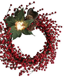The Firefly Garden - Merry Berry - Illuminated Floral Design - Merry Berry is a lighted wreath with lush reds and delicate greens for the holiday season, featuring an illuminated poinsettia. This arrangement is lovely as a door or window accent, as well as a table centerpiece for celebrations.