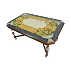 Pre-owned Hand-Painted Dining Table - A beautiful hand-painted dining table. The table features decorative motifs in blue, yellow, green and white with the natural wood color. The table seats 6. It includes a custom fitted glass top.