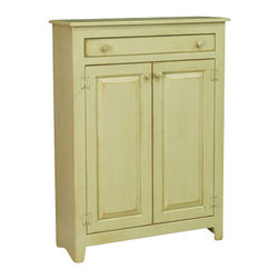 Chelsea Home Furniture - Chelsea Home Ruth Pie Safe - This free-standing 3-shelf pie safe shown in Celery is a pleasant addition to any country home, with a nod to Pennsylvania Dutch style furniture from the 1800's. This piece is constructed in luxurious Eastern White Pine with two long cabinet doors, and slim sliding drawer. This pie safe is both robust and customizable to fit your home. Chelsea Home Furniture proudly offers handcrafted American made heirloom quality furniture, custom made for you. What makes heirloom quality furniture? It's knowing how to turn a house into a home. It's clean lines, ingenuity and impeccable construction derived from solid woods, not veneers or printed finishes over composites or wood products _ the best nature has to offer. It's creating memories. It's ensuring the furniture you buy today will still be the same 100 years from now! Every piece of furniture in our collection is built by expert furniture artisans with a standard of superiority that is unmatched by mass-produced composite materials imported from Asia or produced domestically. This rare standard is evident through our use of the finest materials available, such as locally grown hardwoods of many varieties, and pine, which make our products durable and long lasting. Many pieces are signed by the craftsman that produces them, as these artisans are proud of the work they do! These American made pieces are built with mastery, using mortise-and-tenon joints that have been used by woodworkers for thousands of years. In addition, our craftsmen use tongue-in-groove construction, and screws instead of nails during assembly and dovetailing _both painstaking techniques that are hard to come by in today's marketplace. And with a wide array of stains available, you can create an original piece of furniture that not only matches your living space, but your personality. So adorn your home with a piece of furniture that will be future history, an investment that will last a lifetime.