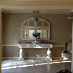 Foyer - White console table with waxed vintage cypress top was built from c. 1880 shutters.  Mirrors hanging above were made from c.1880 French windows.