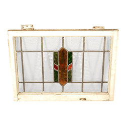 Antiques - Antique English Lead Glazed Stained Glass Window - This is a beautiful antique English lead glazed stained glass window. It has a traditional wooden frame and it features a beautiful *astragal lead glazed textured stained glass window with a distinguished design. This piece may show minor age appropriate signs of wear including wood imperfectionsbut as shown it is overall in very good cosmetic and structural condition.What is astragal (wood or lead) glazing?  As it pertains to later period furniture, it is a method of securing glass to the straight, semi-circular, or shaped moldings found on glass doors and windows of furniture. On newer reproduction furniture, the astragal molding may set atop the glass to give the appearance of glazing where on older English furniture, it is not uncommon for each piece of glass to be cut to shape and glazed into the molding.Other Dimensions (In inches)Glass 16H x 25WFrame 1.75W