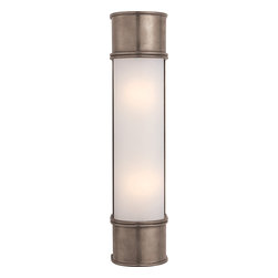 Oxford 18-inch Bath Sconce in Antique Nickel with Frosted Glass - Outfit your modern bathroom with a pair of chic bar sconces for perfect lighting every time. The antique nickel finish and frosted glass casts a flattering light and looks great with a classic subway tile. You'll happily check your make up in this light.
