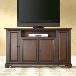 """Crosley - Alexandria 60"""" TV Stand - Enhance your living space with one of Crosley's impeccably-crafted TV stands. This signature cabinet accommodates most 42'' flat panel TVs and is handsomely proportioned featuring character-rich details sure to impress. Raised panel doors strategically conceal stacks of CDs/DVDs, gaming components and various media paraphernalia. Open storage area generously houses media players and the like. Adjustable shelving offers an abundance of versatility to effortlessly organize by design, while cord management systems tame the unsightly mess of tangled wires. Customize our distinct cabinets by selecting one of four collection styles (featuring tapered, traditional, turned or bun feet). This customizable cabinet approach is designed for easy assembly, built to ship and constructed to last. Features: -Raised panel doors.-Five adjustable interior shelves for storing electronic components, gaming consoles, DVDs and other items.-Adjustable levelers in legs.-Recommended TV Type: Flat screen.-TV Size Accommodated: 60"""".-Powder Coated Finish: No.-Gloss Finish: No.-Material: Hardwood and veneers.-Solid Wood Construction: No.-Distressed: No.-Exterior Shelves: Yes -Number of Exterior Shelves: 1.-Adjustable Exterior Shelves: No..-Drawers: No.-Cabinets: Yes -Number of Cabinets: 3.-Number of Doors: 4.-Door Attachment Detail: Pin hinge.-Interchangeable Panels: No.-Magnetic Door Catches: Yes.-Cabinet Handle Design: Knob.-Number of Interior Shelves: 5.-Adjustable Interior Shelves: Yes..-Scratch Resistant : No.-Removable Back Panel: No.-Hardware Finish (Finish: Black): Brushed nickel knobs, steel hardware.-Hardware Finish (Finish: Classic Cherry, Vintage Mahogany): Antique brass knobs, steel hardware.-Casters: No.-Accommodates Fireplace: No.-Fireplace Included: No.-Lighted: No.-Media Player Storage: Yes.-Media Storage: No.-Cable Management: Hole in back for wires.-Remote Control Included: No.-Batteries Required: No.-Weight Capacity: 200 lbs.-Swatch Availab"""