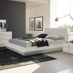 Made in Italy Leather Design Master Bedroom - Modern white Italian bedroom set with exotic eco-leather bed. This Italian bedroom set includes a queen size bed, 2 night stands and a dresser.