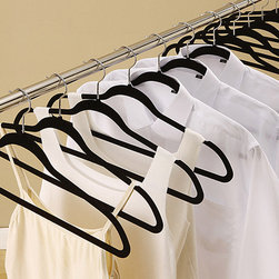 Organize It All - Velvet Suit Hanger - Set of 50 - Perfect for keeping dress clothes stored and protected, this hanger set features non-slip velvet exteriors with sturdy plastic cores and durable metal hooks. Slim and sleek, they make a convenient addition to the wardrobe.   Includes 50 hangers 17.88'' W x 9.25'' H x 0.19'' D Plastic / velvet / metal Imported