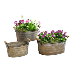 Pier Surplus - Metal Planter Tubs - Set of Three Planters with Wooden Handles #PL221877 - These oval planter tubs make a great way to grow favorite plants! Their antique look is enhanced by the wooden handles that also make them easy to move from one sunny spot to another. They are a wonderful way to fresh kitchen herbs at an arm's length. DIY enthusiasts love their versatility for various craft projects or even as a unique way to present light appetizers at a party!
