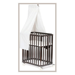 Argington Bam Canopy Drape - Turn a discreet bassinet into the center of attention with this canopy drape. Creating a sort of visual headboard for the bassinet, this little ten-shape fabric will safely shield your infant from drafts and light.