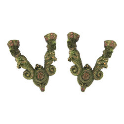 Zeckos - Pair of Beautiful Green Dragon Twin Taper Candle Sconces - Lindorm Dragons are often depicted as serpentile creatures with two legs and no wings. Usually, they have long tails and shorter legs, and their legs serve like arms. They are extremely dangerous, and very quick. Made of solid cold cast resin, this beautiful pair of wall mount double taper candle sconces features growling Lindorm Dragons, each with a taper style candle holder on its head. The holders are hand-painted with an antiqued finish, making the actual holders look old and cracked. They are finished with metallic gold paint for an extra accent. Measuring 12 1/2 inches tall, 10 1/2 inches wide, and 5 3/4 inches deep, they will make a great addition to any home, and make a great gift.