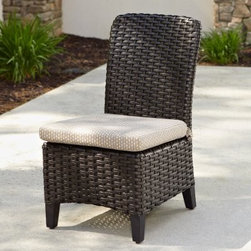 Anacara Carlysle All-Weather Wicker Side Chair - You can pull the Anacara Carlysle All-Weather Wicker Side Chair around your patio table or you can line them up next to the pool, just not so close that you get splashed when the neighbor kid that nobody invited over starts doing cannonballs. Even if he does, you're covered thanks to the moisture-resistant nature of the resin wicker that covers this versatile patio chair. Resin wicker looks and feels like real, woven rattan, but its synthetic composition makes it resistant to cracking, rot and weathering. The plump seat cushion is covered in a durable, all-weather fabric that's offered in a range of colors and styles, so take the time to customize this all-purpose outdoor chair to your own needs and style.About AnacaraFounded in 1989, The Anacara Company was established to not only design and produce fine furnishings for today's indoor and outdoor casual lifestyles, but to also manufacture the very best wicker and rattan products on the market. Having expanded over the years, the Anacara Company has designed resin wicker furniture that has ranged from traditional to transitional and contemporary designs. Their resin furniture not only features superb craftsmanship, but also unsurpassed comfort. Wanting to increase your quality of life, the Anacara Company focusing on making their collections ...Beautiful and Durable...even in the rain.