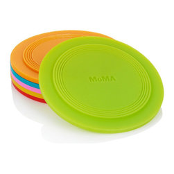 MoMA - Stacking Coasters (Set of 6) - Stack-able and waterproof, this set of coasters feature a raised border that holds condensation, further protecting surfaces from water damage. The six bright coaster colors serve as an easy system to help guests remember and easily find their beverage. Made of heat-resistant and water-resistant silicone, these coasters reflect the Museum's effort to document innovative uses of materials. Dishwasher safe. MoMA logo embossed on the underside of each coaster. Made for both indoor and outdoor use. Set of Six.
