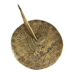 """Zeckos - Bronze Finish Flying Eagle Sundial American Patriotic - This beautiful round garden sundial will add a distinct look of class to your garden, patio or pool, whether or not you use it with a pedestal. Made of cold cast resin, this gorgeous sundial features a flying American Bald Eagle on the face, with the words """"In God We Trust"""" on the right hand side, has an American flag for a gnomon, and has numbers around the outside to help give you the time. Measuring 11 inches in diameter, the sundial has a bronzed finish that gives it the look of cast metal. It will look beautiful in your garden for years to come, and won't need to be repainted. We have a limited number of these, so don't miss out. Get yours now"""
