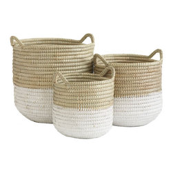 White Dipped Barrel Baskets - In many societies across the world, barrel baskets were dipped in a paint-like solution in order to keep them watertight. Although ours are not, they are still a great way to mix function with style. Because they are so tall, they are the perfect solution for holding extra wrapping paper rolls or tall bouquets of reed.