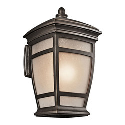 Kichler 1-Light Outdoor Fixture - Rubbed Bronze Exterior - One Light Outdoor Fixture. Traditional flair is complimented by modern lines on this lighting outdoor wall sconce. From the mcadams collection, it features a warm and stylish rubbed bronze finish that compliments the subtle tapered shape. A light umber etched seedy glass shade completes the look. Height from center outlet: 9""