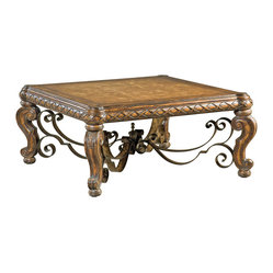 Ambella Home - Morales Cocktail Table - Boasting a eucalyptus and koto veneer marquetry top, this Spanish-style hardwood cocktail table has all the elements you desire for your formal home. A forged iron stretcher between the legs adds stylistic detail.