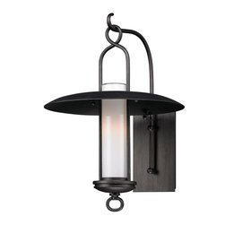 Troy Lighting - Troy Lighting Carmel Transitional Outdoor Wall Sconce X-1333B - The slim and elegant profile of this Troy Lighting Carmel Transitional Outdoor Wall Sconce gives it a stylish look that works well with modern or traditional home architecture. The cylinder of opal white glass is housed in a charming lantern with flaring shade suspended from a hook on an elegant arm extending from a narrow back plate.