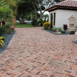 Genuine Clay Pavers - This installer used BrickAmerica's Queen Chicago Genuine Clay Pavers to perfectly compliment the exterior color palette of this residence.  The rich colors in clay pavers will never fade and therefore require very little maintenance.