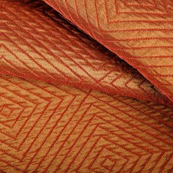 Impulse Geometric Upholstery Fabric in Cinnamon - Impulse Geometric Upholstery Fabric in Cinnamon has a tan and orange diamond pattern with a slight sheen that gives a metallic look. Ideal for upholstering sofas, chairs, and ottomans or for creating custom bedding and pillows. Made in the USA from a blend of 18% cotton, 32% olefin, and 50% polyester. This upholstery fabric passes 30,000+ double rubs on the Wyzenbeek Abrasion Test. Passes CA117 Test, UFAC 1 Width 53″; Repeat: 5 3/4″ H; 5″V