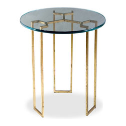 Interlude - Triad Side Table - With it's triumvirate of legs, this a truly taking table for your turf. The clear glass top highlights the unique, geometric design of the base. You'll probably be loathe to cover it up. Don't worry when you do, though, it will still look great.