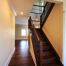 Contemporary Staircase by Feil Inc. Wood Flooring & Stairs