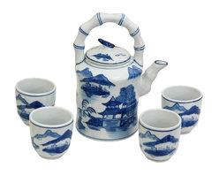 Oriental Unlimited - Blue & White Landscape Porcelain Tea Set - Includes large tea pot and 4 classic handless Japanese style tea cups. Fine Oriental porcelain tea set. Cups: 2.5 in. Dia. x 2.75 in. H. Teapot: 6.5 in. W x 4.5 in. D x 8 in. H (3.5 lbs.)