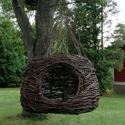 Willowbee - Willowbee from Dreamweaver Nests is a big step above a hammock, This hanging willow nest is the ultimate natural escape.  It's hard to describe the serenenity that comes from relaxing in this six foot diameter willow nest as it sways slowly in the breeze.  Willowbee and other nests are handmade with sustainable materials in Northern Wisconsin and Northern Michigan