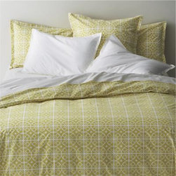 Taza Twin Duvet Cover - White medallions trellis on citron in soothing geometrics inspired by Moroccan tiles. Reversible duvet cover features a hidden button closure at the bottom and interior fabric ties to hold the insert in place. Duvet inserts and bed pillows also available.