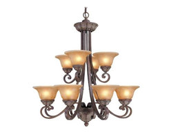Dolan Designs Lighting - Twelve-Light Chandelier - 822-38 - This two-tier chandelier features twelve amber glass shades, which have a brown marbling and create a warm illumination. An organic leaf pattern appears just below each shade as well as on the cap and the finial. Scrolling arms add movement to the piece and act as the arms for the shades. Includes six feet of chain. Takes (12) 60-watt incandescent G16.5 bulb(s). Bulb(s) sold separately. UL listed. Dry location rated.