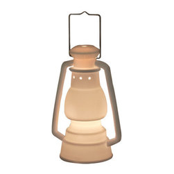 """Talk of the Trails Lamp - A lantern is a must-have camping accessory; after dark I literally carry one with me everywhere I go. Besides their functionality, they are fashionable too. Created in the likeness of a classic kerosene lantern, I am obsessed with this porcelain lamp, it can """"burn"""" indoors anytime of the year."""