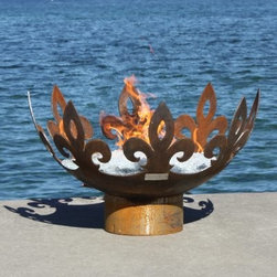 "John T. Unger Fiery Fleur-De-Lis 37 in. Sculptural Firebowl - Add a regal flair to your next outdoor gathering with the John T Unger Fiery Fleur-De-Lis 37 in. Sculptural Firebowl. This .25-inch plate steel bowl is made of 100% recycled material and features a rich rust patina finish and fleur-de-lis carvings. It brings a level of majesty to even the most modest gardens and requires no maintenance whatsoever even when left outdoor year-round. A small hole in the bowl's center allows for drainage but can also be used to convert this wood-burning firepit to clean-burning LP or natural gas. This modern take on classical design measures 37 diam. x 22H inches and makes a wonderful addition to any backyard or patio. About John T. Unger StudioJohn T. Unger has been making art professionally since 1995 and turned it into a full-time living in 2000. A jack of all trades Unger has made a successful career as a writer poet illustrator web designer actor teacher and much much more. But above all he is known for the studio that produces most striking and original fire pits anywhere. They are green products that are built to the highest standard both technically and aesthetically from recycled or re-used materials to make as little an impact on climate and environment as possible. The studio's mantra is """"Sustainable design with an edge """" and it shows in every brilliant design they produce. Each fire pit is designed for permanence with a style drawn from primal metaphor and classical elements that speak to every generation. No other fire pit line is made with such care and attention to detail as those from the John T. Unger Studio."