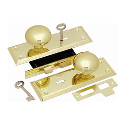 First Watch Security - Keyed Knob Mortise Lockset in Polished Brass - Brass knobs. Brass plated steel trim plates. Case-hardened steel case. Lock bolt is key activated both inside and outside. Requires mortise cutout. Polished Brass Finish
